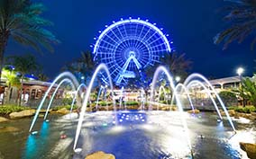 The Coca Cola Orlando Eye Ferris Wheel With Water falls at night